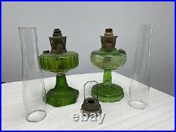 TWO Antique Green glass Aladdin kerosene lamps